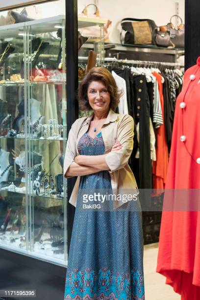senior business owner working at a clothing store - opening event stock pictures, royalty-free photos & images