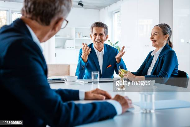 senior business people in the office - blue suit stock pictures, royalty-free photos & images