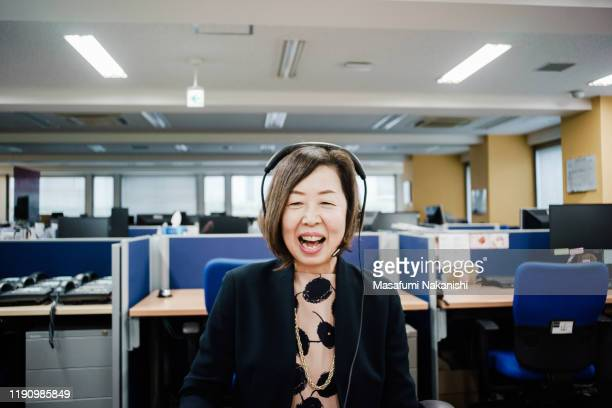 senior business woman having a video chat - video conference stock pictures, royalty-free photos & images