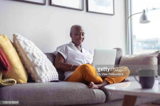 senior business woman working from home - computer equipment stock pictures, royalty-free photos & images