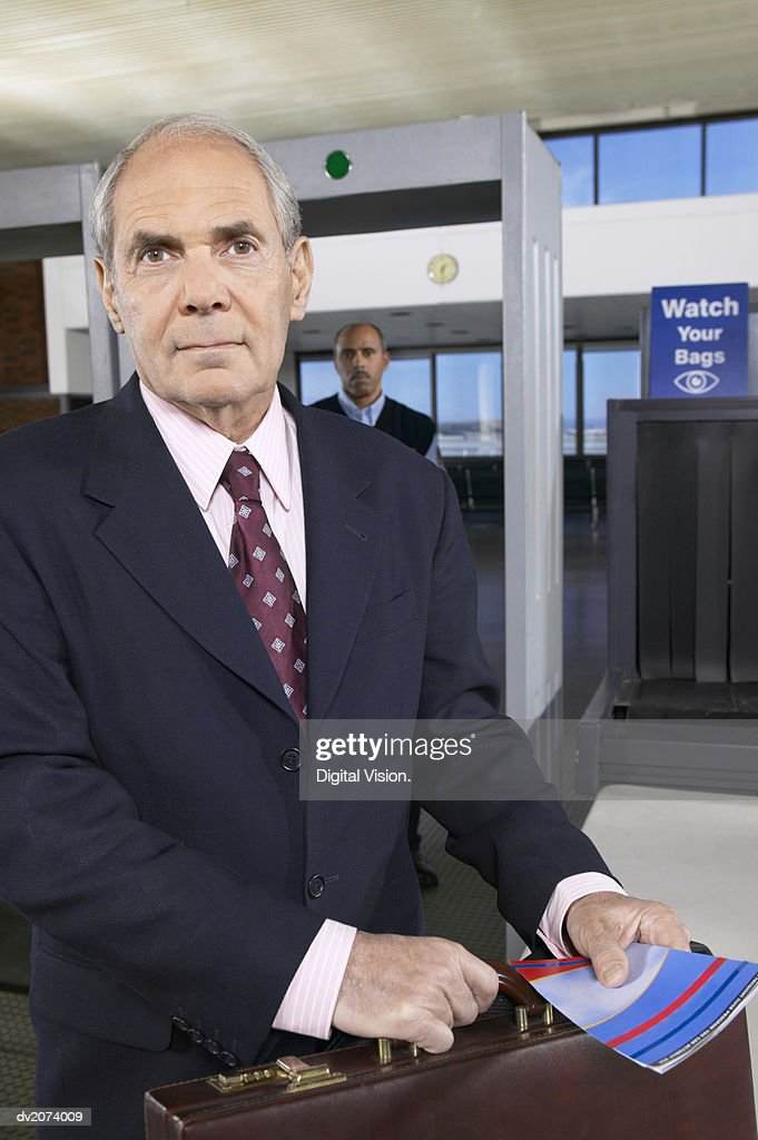Senior Businessman at Airport Customs : Stock Photo