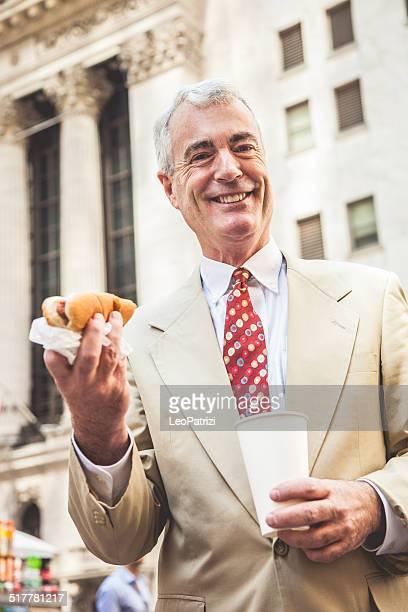Senior businessman buying an hot dog