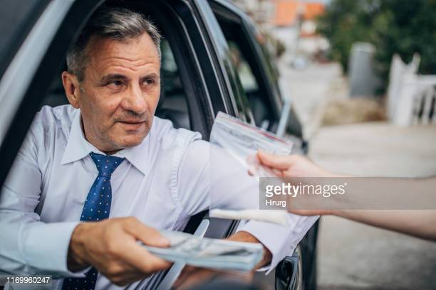 senior businessman buying cocaine - drug dealer stock pictures, royalty-free photos & images