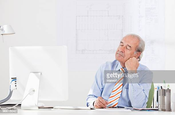 Senior businessman daydreaming
