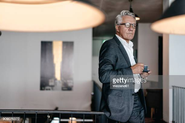 senior businessman drinking coffee, looking worried - grey suit stock pictures, royalty-free photos & images