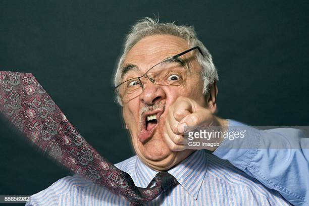 senior businessman gets attacked - punching stock pictures, royalty-free photos & images