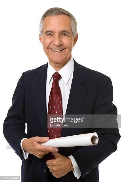 Senior businessman holding architectural plans