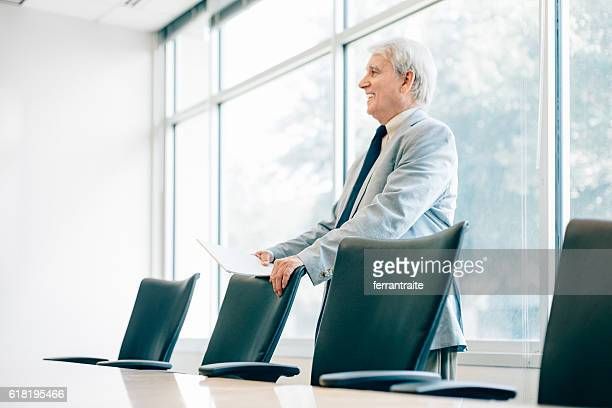 Senior Businessman in Board Room