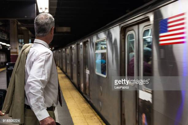 senior businessman in new york subway - new york city subway stock pictures, royalty-free photos & images