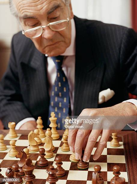 Senior Businessman Playing Chess