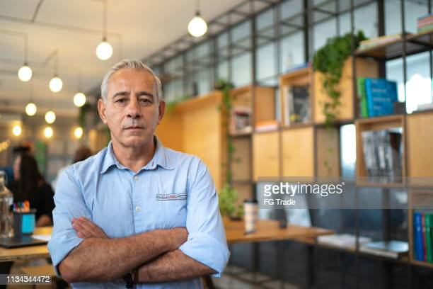 senior businessman portrait at startup modern office - serious stock pictures, royalty-free photos & images