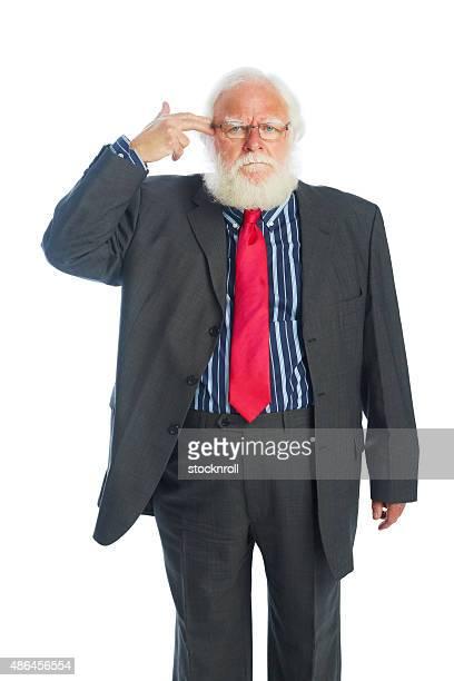 Senior Homme d'affaires en costume qui font semblant de faire une tête