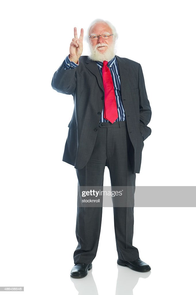 Senior businessman showing the victory sign : Stock Photo