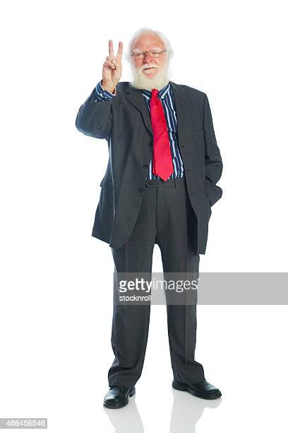 Senior businessman showing the victory sign