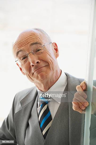 senior businessman, smiling, portrait - receding hairline stock pictures, royalty-free photos & images