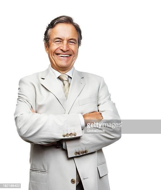 Leitender Geschäftsmann mit Hände gefaltet lächelnd