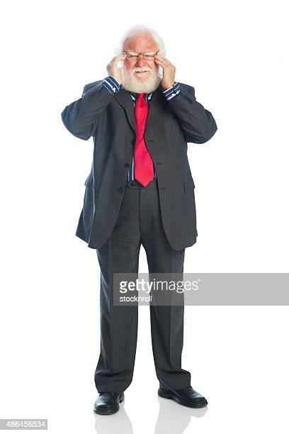 Senior Homme d'affaires souffrant de maux de tête
