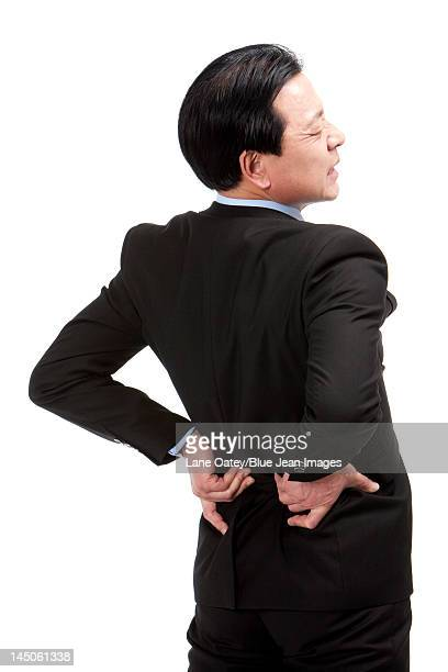Senior businessman suffering from low back pain