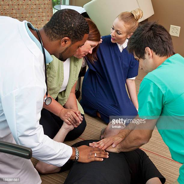 Senior businessman with heart attack getting external heat massage (CPR)