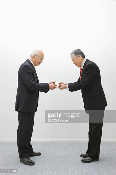 Senior businessmen exchanging business cards