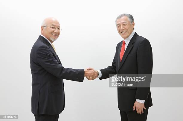 Senior businessmen shaking hands