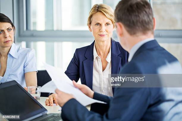 Senior businesswoman during a staff meeting