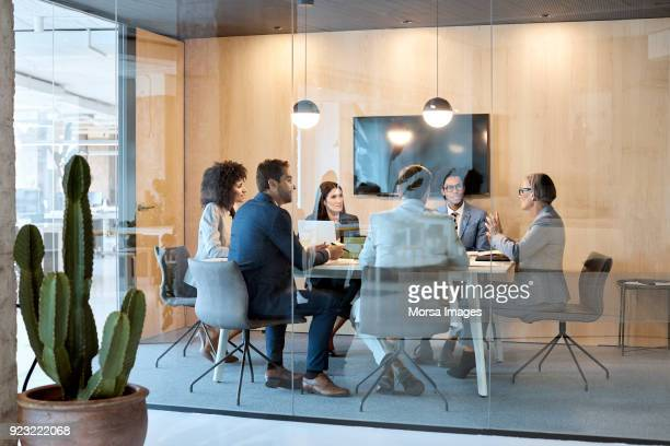 senior businesswoman explaining strategy at office - board room stock pictures, royalty-free photos & images