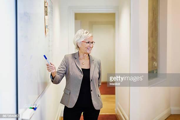 Senior businesswoman giving presentation in office