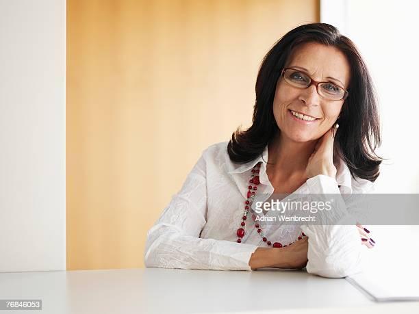 Senior businesswoman in office smiling, portrait