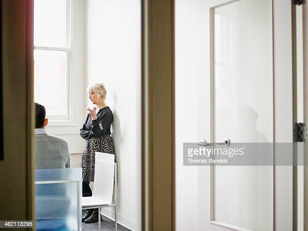 Senior businesswoman leading discussion