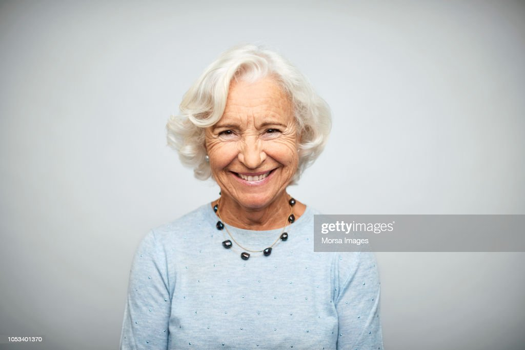 Senior businesswoman smiling on white background : Stock Photo