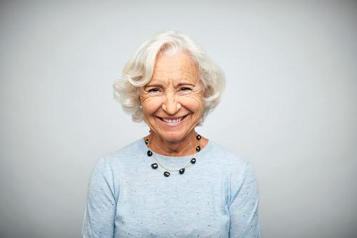 Senior businesswoman smiling on white background - gettyimageskorea
