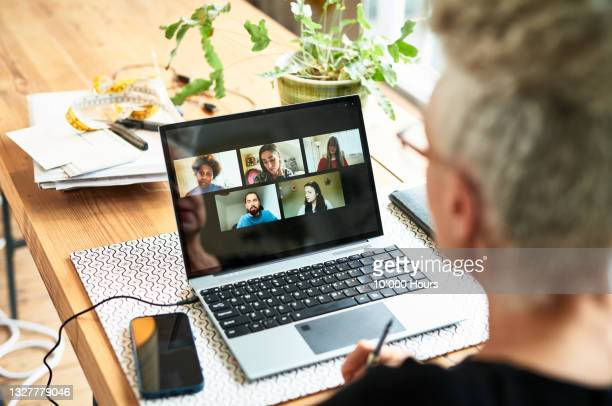 senior businesswoman using laptop for team meeting video conference - greater london stock pictures, royalty-free photos & images