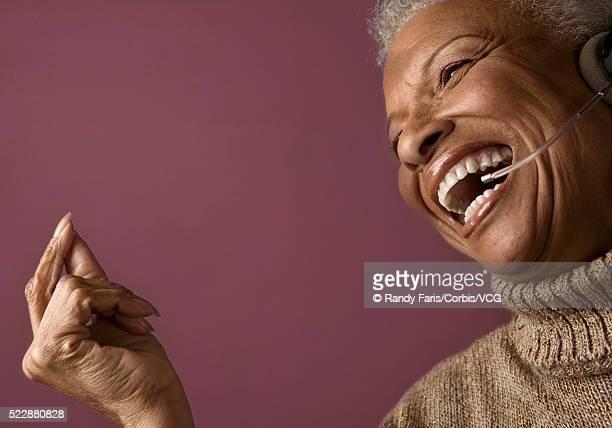 Senior Businesswoman Wearing Telephone Headset