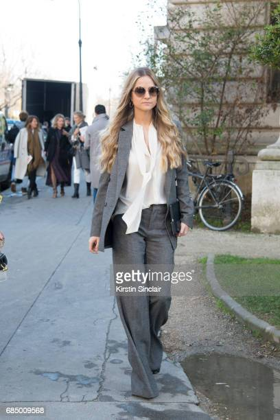 Senior buyer at Net a Porter Holly Estelle Russell wears a Chloe bag Prada suit Iris and Ink shirt on day 3 during Paris Fashion Week Autumn/Winter...