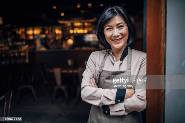 senior cafe owner - restaurant manager stock pictures, royalty-free photos & images