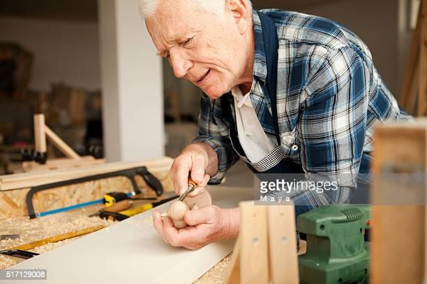 Senior carpenter in his workshop