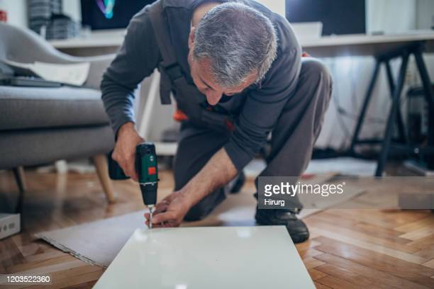 senior carpenter is working - installing stock pictures, royalty-free photos & images