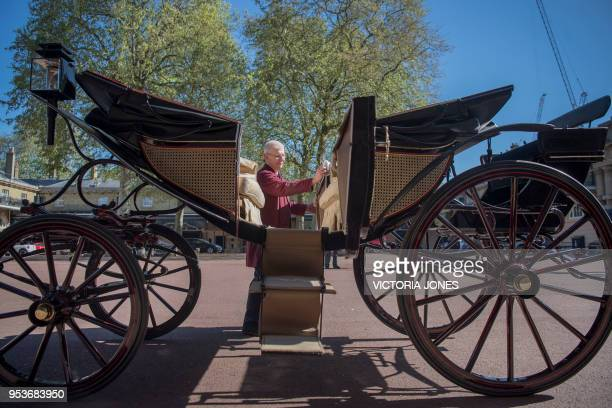 Senior Carriage Restorer Martin Oates polishes the Ascot Landau carriage which will carry Britain's Prince Harry and wife Meghan Markle along the...