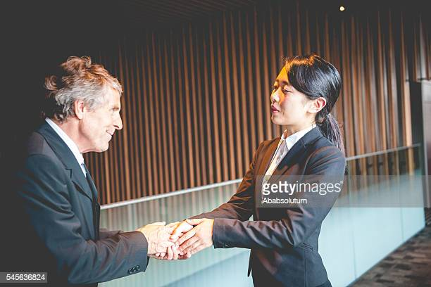 Senior Caucasian Businessman and Japanese Entrepreneur Shaking Hands, Kyoto, Japan