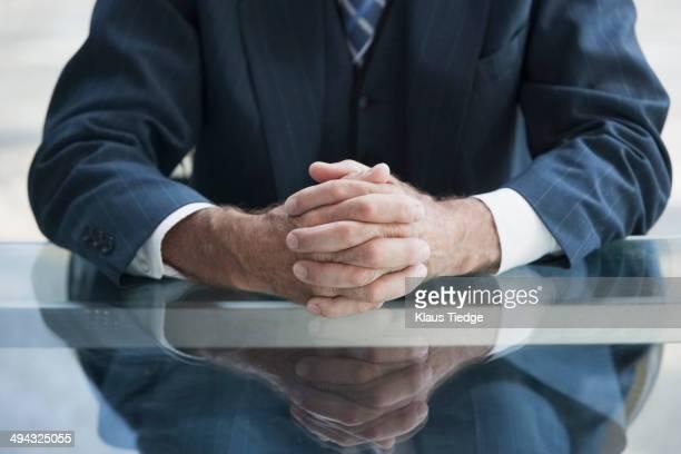 Senior Caucasian businessman's folded hands