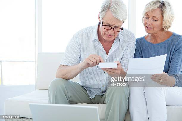 Senior Caucasian couple doing home finances