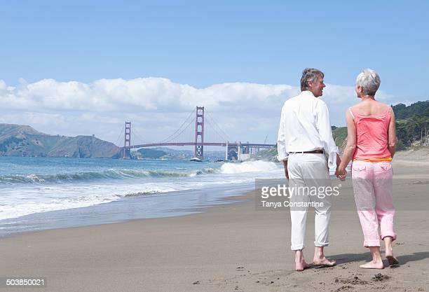 Senior Caucasian couple walking by Golden Gate Bridge, San Francisco, California, United States