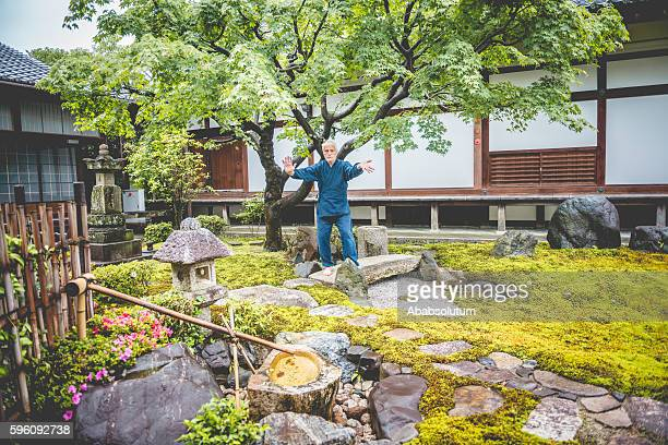 Senior Caucasian Man Exercising Karate in Buddhist Temple, Kyoto, Japan
