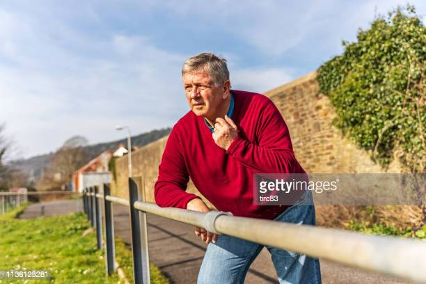 senior caucasian man in welsh countryside - construction barrier stock pictures, royalty-free photos & images