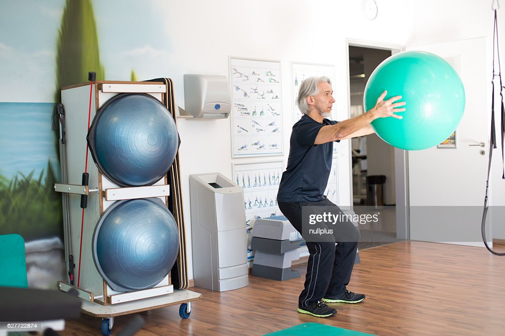 Senior Caucasian Man Working Out at the Gym : Stock Photo