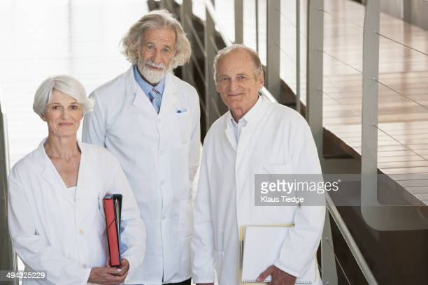 Senior Caucasian scientists smiling in office