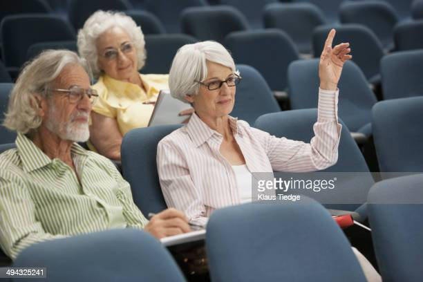 senior caucasian students sitting in classroom - participant stock pictures, royalty-free photos & images