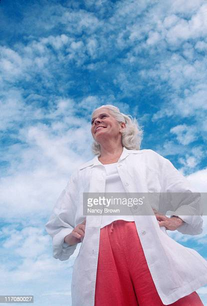 Senior Caucasian woman against sky from below.