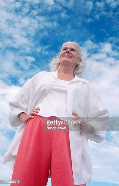 Senior Caucasian woman against sky.